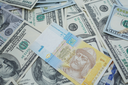 one hundred dollars: one hryvnia and one hundred dollars