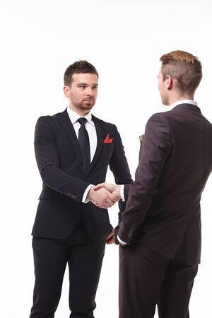 two businessmen shake hands Foto de archivo