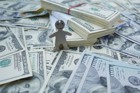 budgets: notes of dollars and little man Stock Photo