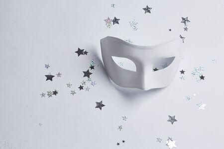 white mask: white venetian mask on a white background Stock Photo