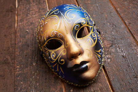 white mask: Venetian mask on a wooden table