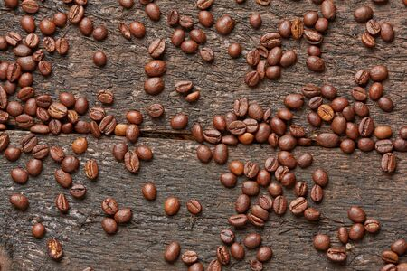 scattered: coffee beans scattered on the wooden table