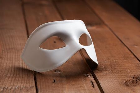 masque: White Venetian mask on the table