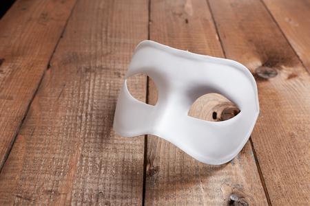 face mask: White Venetian mask on the table