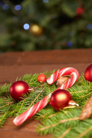 red christmas ball: Christmas tree branch, candy, cones, balls Stock Photo