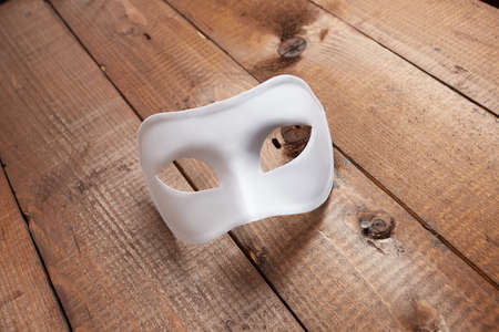 undecorated: White Venetian mask on the table