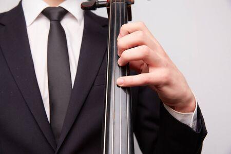 cellos: young man with a cello Stock Photo