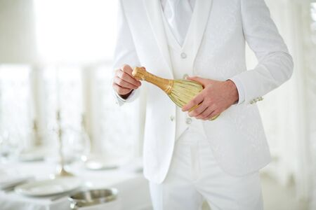 opens: man opens champagne