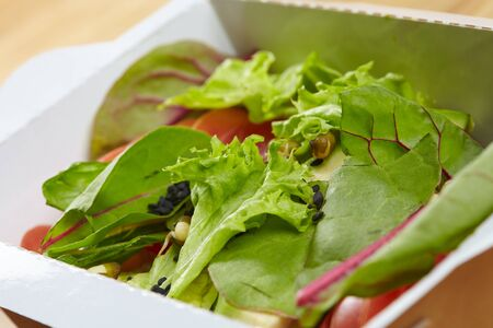 delivery box: vegetarian dish vegetables, herbs in a cardboard box