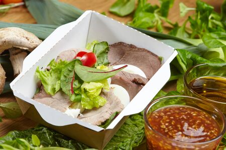 cooked meat: dietary delicious dish cooked meat with vegetables and greens Stock Photo