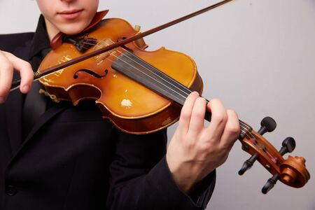 fiddler: young man with a violin Stock Photo