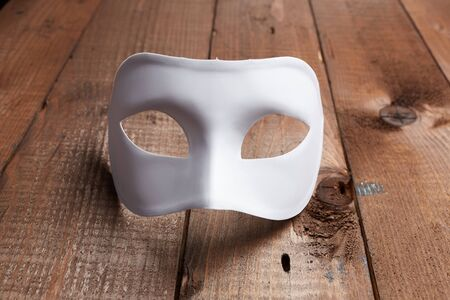 venetian mask: White Venetian mask on the table