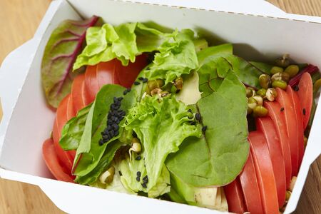vegetarian dish vegetables, herbs in a cardboard box