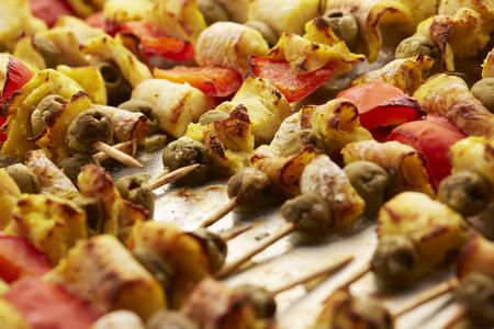 appetizer skewers the fish with vegetables, olives Stock Photo