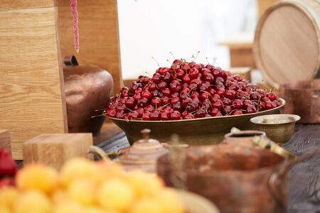 delicious, beautiful cherry in a large bowl Banco de Imagens