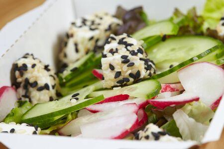 vegetarian vegan vegetable dish, fresh herbs in a cardboard box