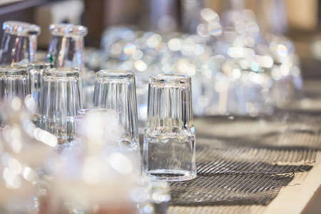 Glass jars and glasses on a buffet abstract