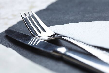 knife and fork on a table a napkin