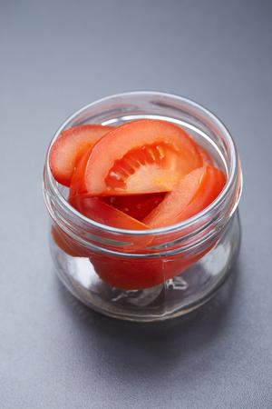ingredient fresh tomatoes in a jar Archivio Fotografico