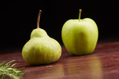 pear and apple on the table