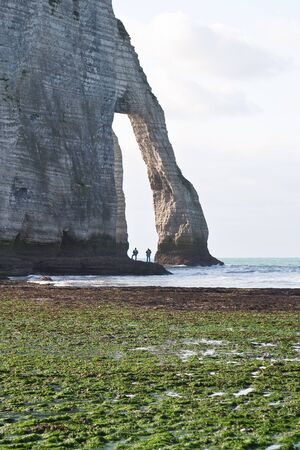 The famous cliffs at Etretat in Normandy, France. Tide sea Stock Photo