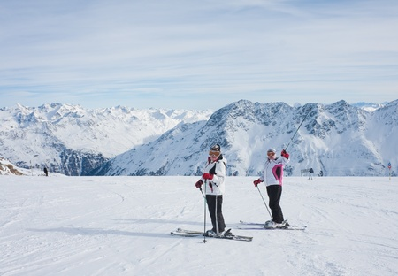 Skiers mountains in the background Stock Photo