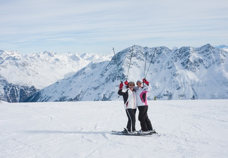 Skiers mountains in the background Stock Photo - 10506175