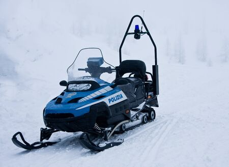 police snowmobile in the mountains, Italia