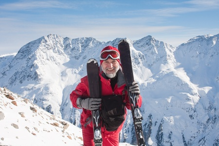 Skier mountains in the background Stock Photo - 10800396