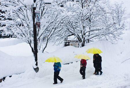 walking through city during snowstorm photo