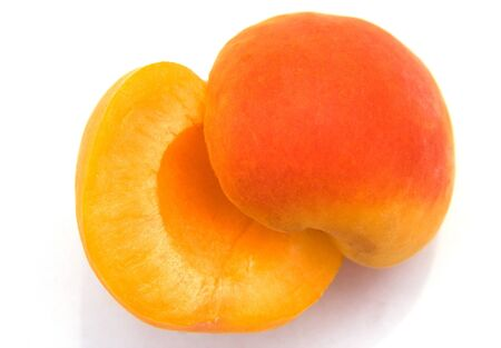 Ripe apricot close-up isolated on white background. Small depth to sharpnesses photo