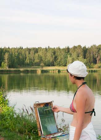 Painter-girl en plein air photo