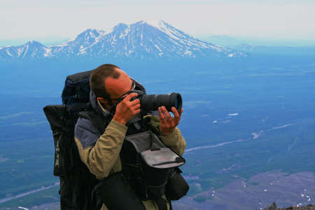 expeditions: Photographer with equipment operates in expeditions; Kamchatka Stock Photo