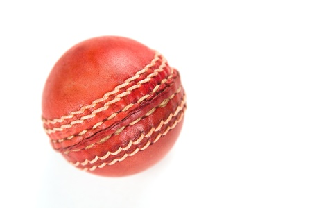 cricket ball: red cricket ball, isolated on white background. Stock Photo