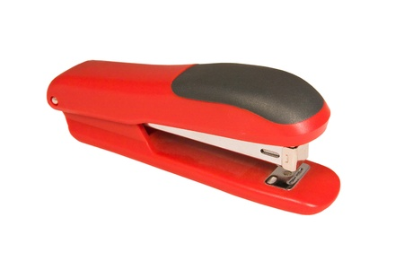 Red stapler isolated on a white background photo
