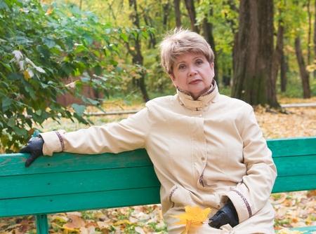 portrait of woman in autumn park photo