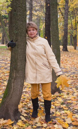 portrait of woman in autumn park photo