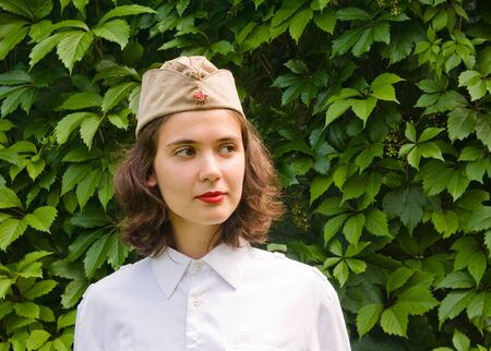 Girl wearing a soviet soldier cap photo