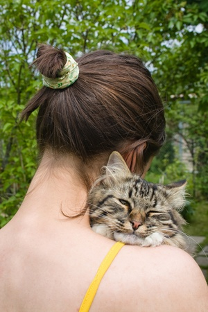 Girl teenager holding and hugging her cat Stock Photo - 11219847