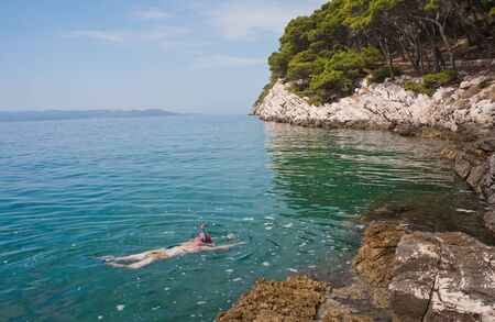 Woman with snorkelling and swimming in the sea Stock Photo - 11269677