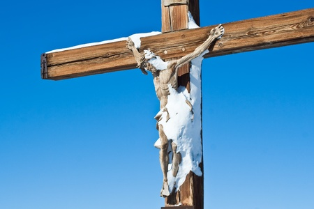 Crucifixion of Jesus Christ, sprinkled with snow photo