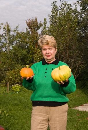 Senior woman with pumpkins photo