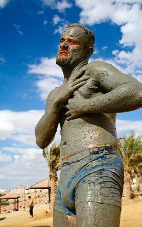 Mud treatment at the Dead Sea, Jordan