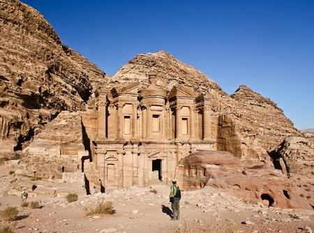 Tourist and the Monastery at Petra Jordan photo