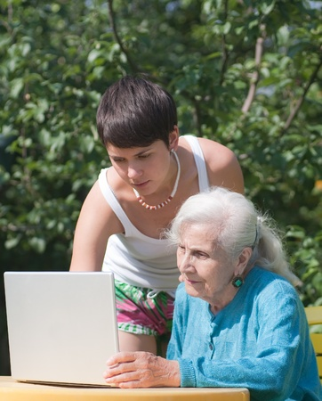 Grandmother and granddaughter with laptop