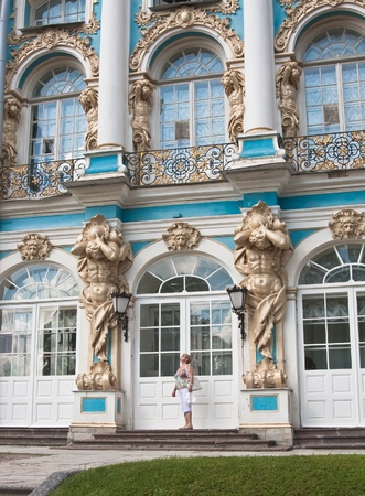 A tourist on the steps of the Great Catherine Palace. Tsarskoye Selo. Russia