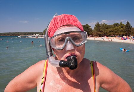 Woman with a mask and snorkel for swimming photo