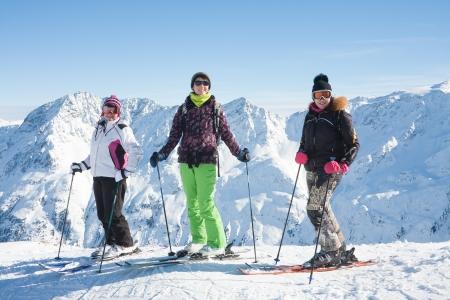 Skiers mountains in the background  Ski resort  Solden  Austria
