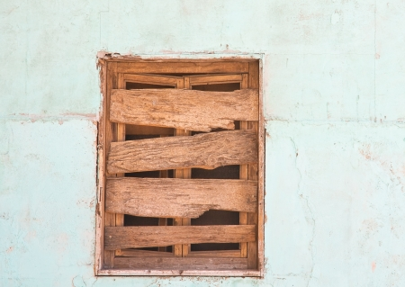 downtrodden: Boarded-up window Stock Photo