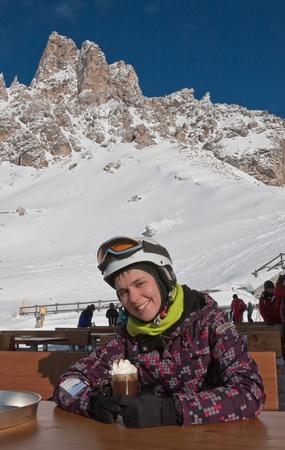 selva: The girl at the table mountain cafe. Ski resort of Selva di Val Gardena, Italy